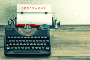 Image of typewriter and 2019 conference program